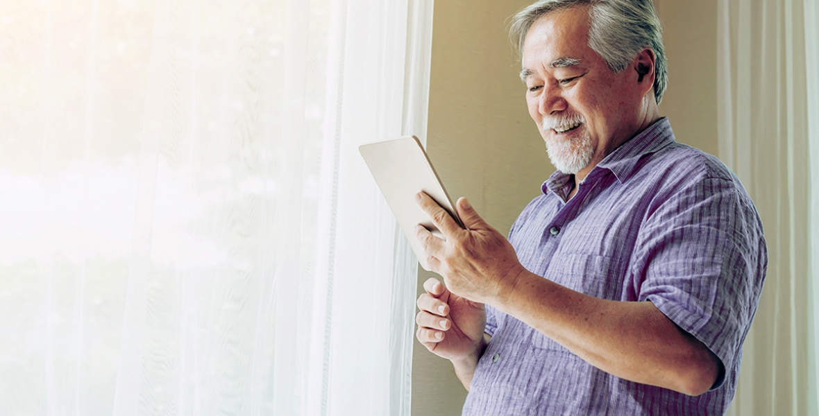 Man with a tablet smiling